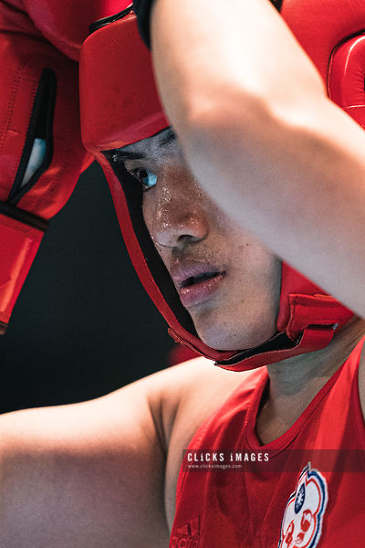 AMMAN, JORDAN - MARCH 08: Nien Chin Chen of Chinese Taipei (red) preparing the fight during Women's Welter (64-69kg) fight ag...