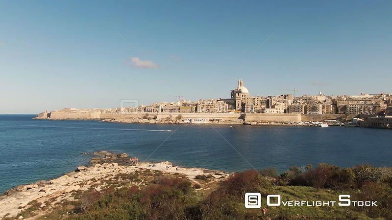 Aerial ascending view of the towns of Valletta from Manoel island, Malta