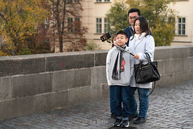 Tourists taking a selfie on Charles Bridge in Prague, Czech Republic