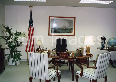 1991 - Interior of the  U.S. embassy and chancery complex in London, England - American flag and empty chairs in an office