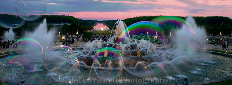 Versailles gardens and fountain at sunset