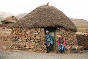Women at hut in a Basotho village, Sani Top, Lesotho