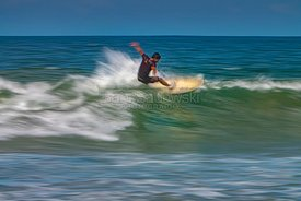 Surfer riding a wave abstract