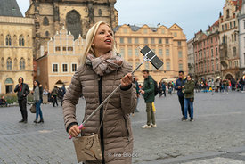 Tourists taking a selfie at Old Town Square in Prague, Czech Republic