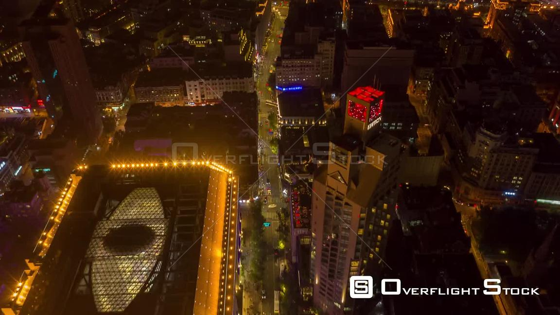 China Shanghai Aerial Hyperlapse at night, vertical to birdseye view crossing river looking into financial district