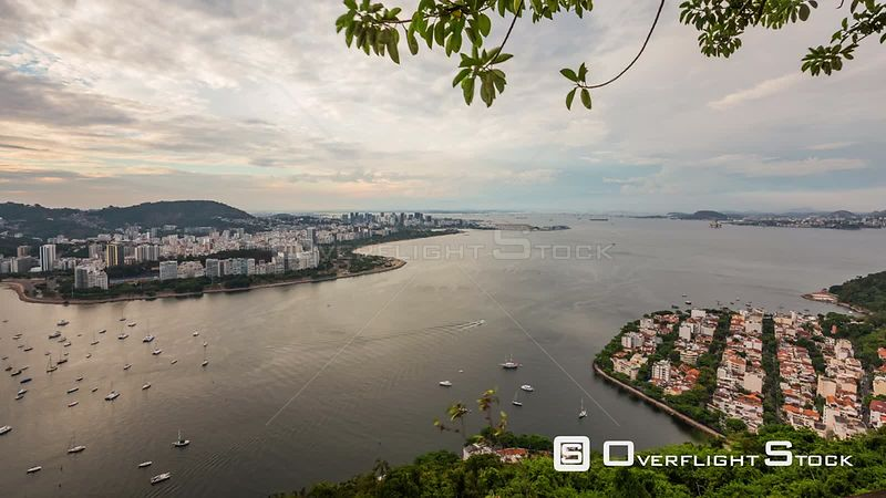 Rio de Janeiro Brazil Rio De Janeiro cityscape panning time lapse at dusk from lower Sugar Loaf Mountain