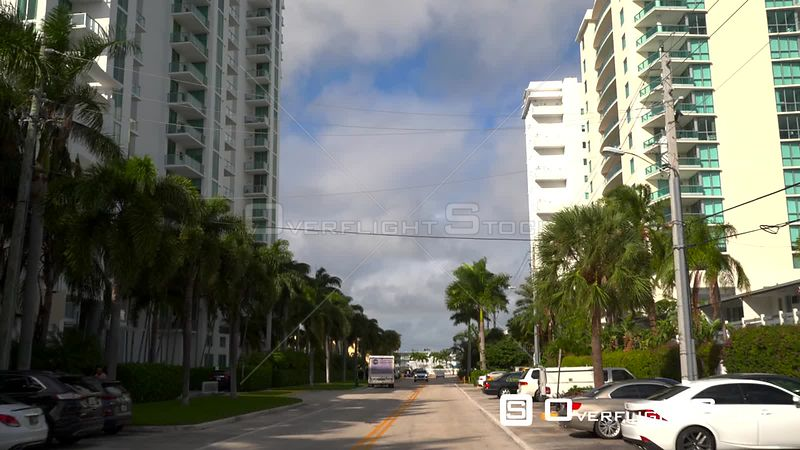 Driving Down Suburban Road Camera Tilt up to See Sky Florida