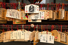 Ema, wooden plaques where prayers or wishes are written found nearby a temple in Harajuku, Tokyo, Japan