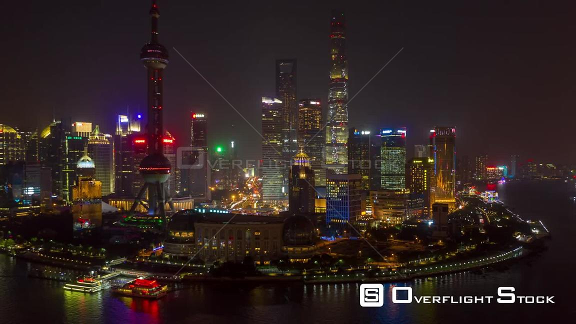 China Shanghai Aerial Hyperlapse flying around landmark waterfront at night with views of traffic