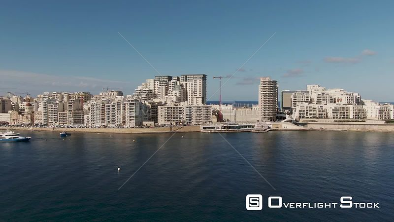 Aerial panning view of the seafront of Sliema, in Malta