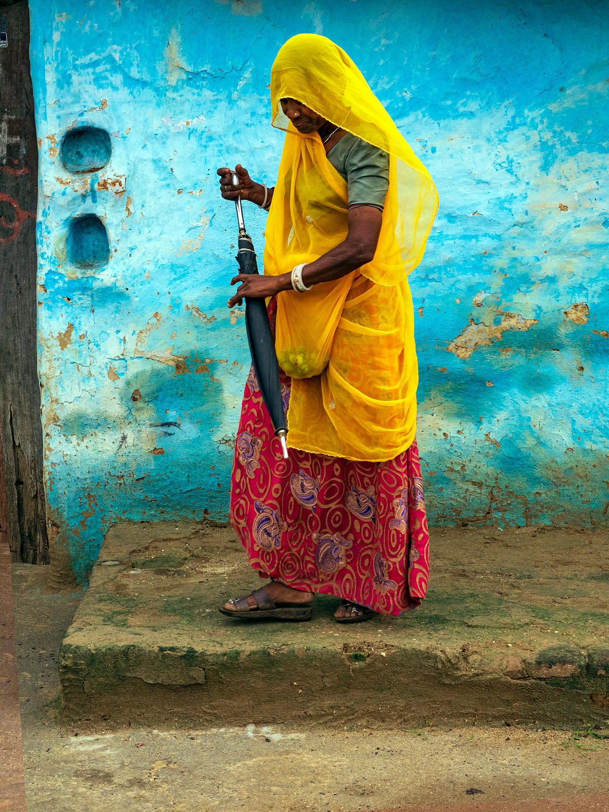 A rural woman gets ready to go out