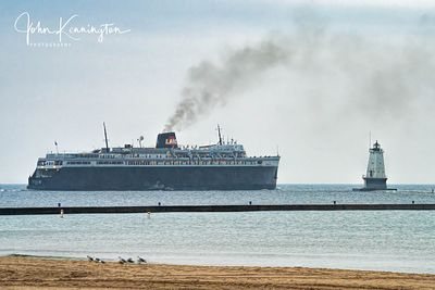 SS Badger Passing Ludington Breakwater Lighthouse, Lake Michigan, Luddington, Michigan