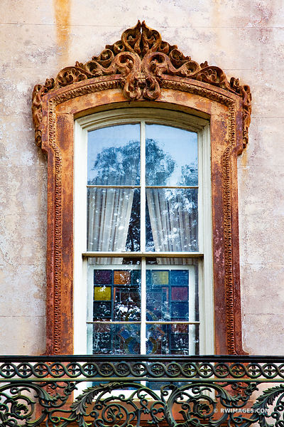 OLD BUIDLING ORNAMENTAL WINDOW HISTORIC SAVANNAH GEORGIA COLOR VERTICAL