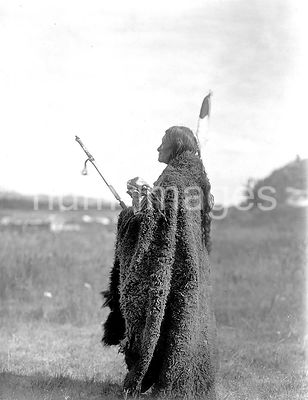 Edward S. Curits Native American Indians - Photograph shows Saliva, an Oglala Sioux priest, dressed for the Hu Kalowa Pi cere...