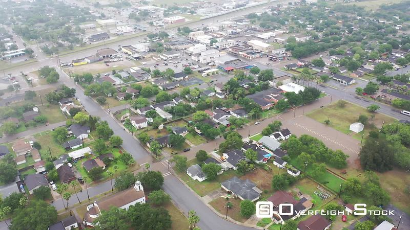High flyover approaching downtown with light rain, La Feria, TX, USA