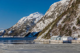 Ferry in Fjord Passing through Sea Ice near Grey River Outport in Newfoundland