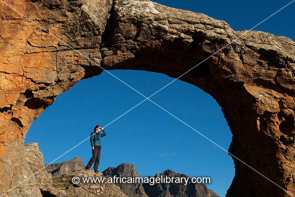 The Three Bushmen (Devil's Knuckles) mountains seen through a rock arch, Sehlabathebe National Park, Lesotho