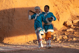 Mongol kids dancing to Mongolian music instruments at the Flaming Cliffs, Bayanzag, in the south Gobi desert, Mongolia.