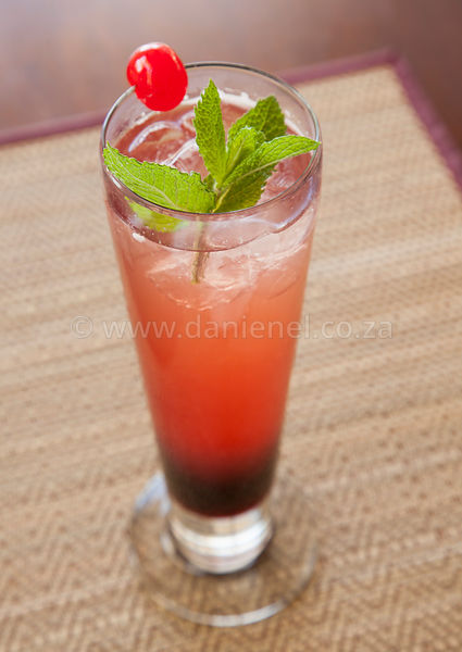 A delicious vodka berry cocktail in talll glass