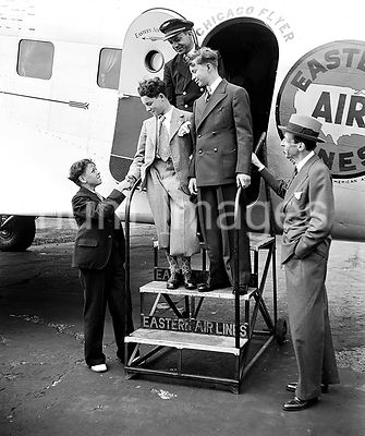 Unidentified group of boys at Chicago Flyer, Eastern Airlines airplane door ca. 1935