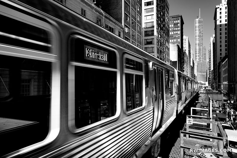 EL TRAIN IN MOTION DOWNTOWN CHICAGO ILLINOIS BLACK AND WHITE