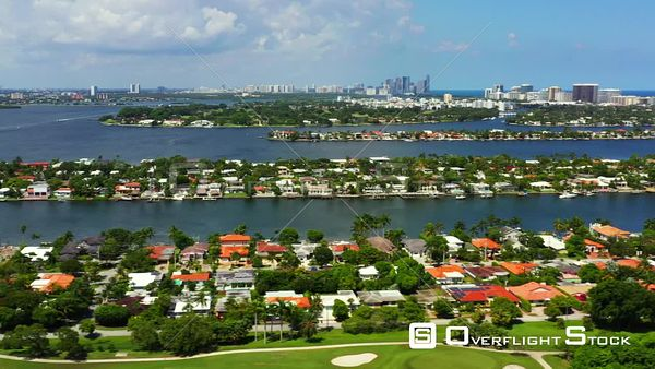 Aerial fast pan Miami Beach Normandy Shores neighborhood view of bay and ocean