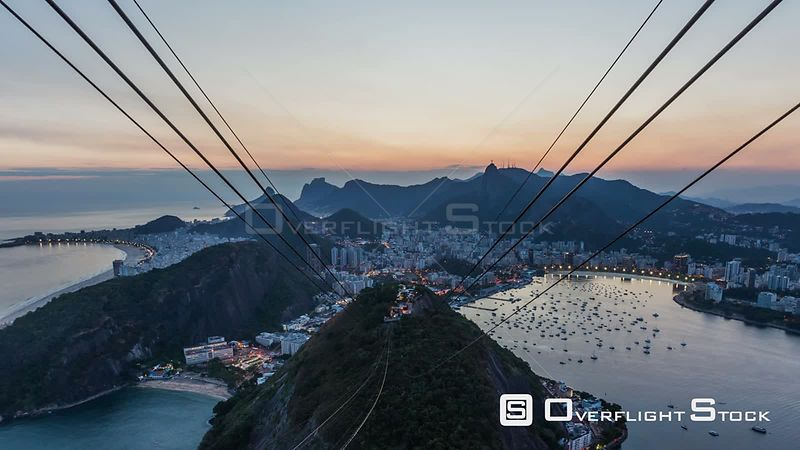 Rio de Janeiro Brazil Rio De Janeiro cityscape zooming time lapse after sunset over Christ The Redeemer from Sugar Loaf Mountain