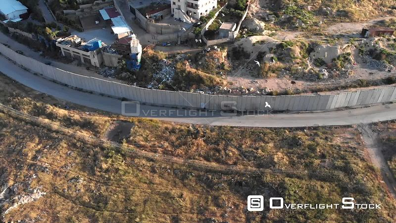 Drone Flight View of East Jerusalem Security Wall Divide Between Israeli and Arab Neighborhood  Anata and Pisgat Zeev, Israel