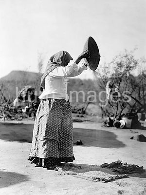 Edward S. Curtis Native American Indians - Papago Indian woman cleaning wheat (Winnowing wheat) ca. 1908
