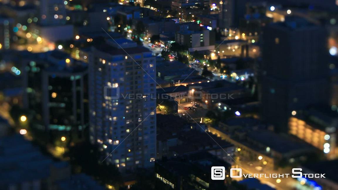 Seattle Washington State USA Panning Seattle cityscape time lapse at night using a tilt shift lens with vertical center in fo...