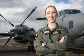 Polot Officer Olivia Landau in front of KA350. Air Warfare Officer under training