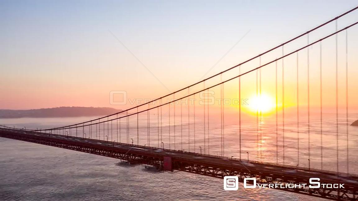 San Francisco Aerial Sunset hyperlapse of Golden Gate Bridge path traveling toward Marin Co.