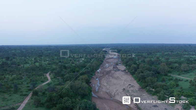 A Flight Down a Near Dry River Bed in Greater Kruger National Park in South Africa.