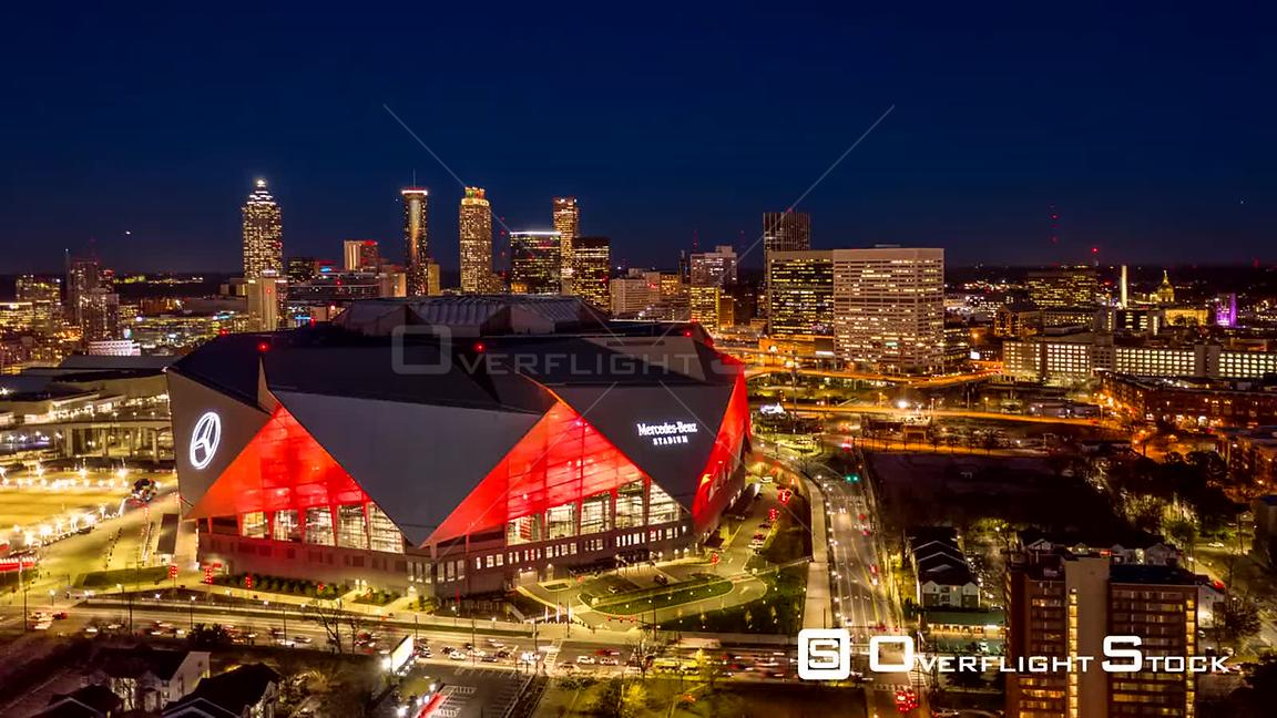 Atlanta Aerial Dusk to night hyperlapse rotating around MercedesBenz Stadium with bright red lights