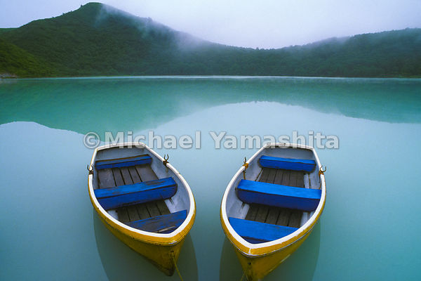Two colorful rowboats in the mist on Katanuma Lake.