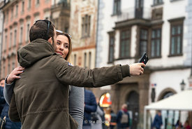 Tourists taking a selfie in Old Town Square in Prague, Czech Republic