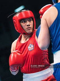 AMMAN, JORDAN - MARCH 08: Nien Chin Chen of Chinese Taipei (red) in action during Women's Welter (64-69kg) fight against Shin...