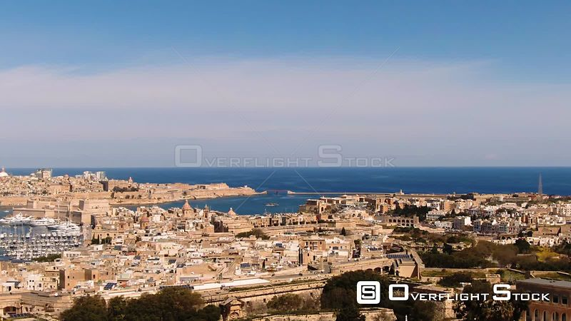 Aerial approaching view of the towns of Vittoriosa and Valletta and the entrance of the Grand Harbour in Malta