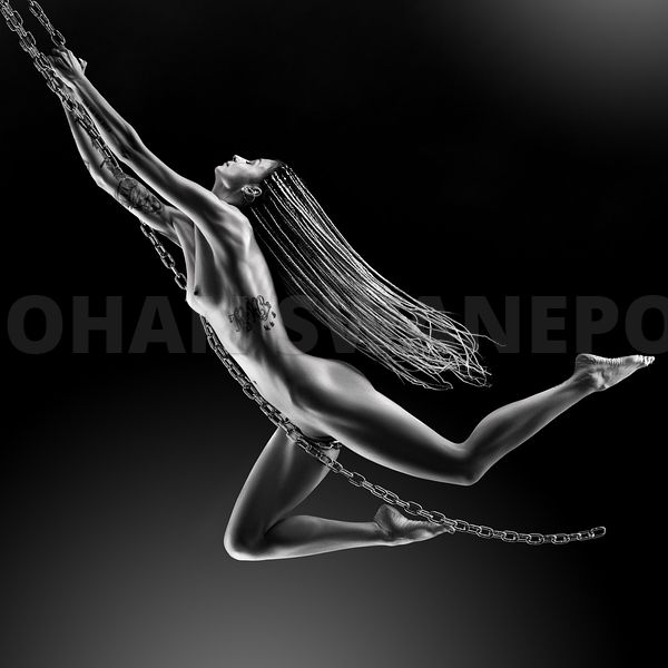 Nude woman swinging on chains