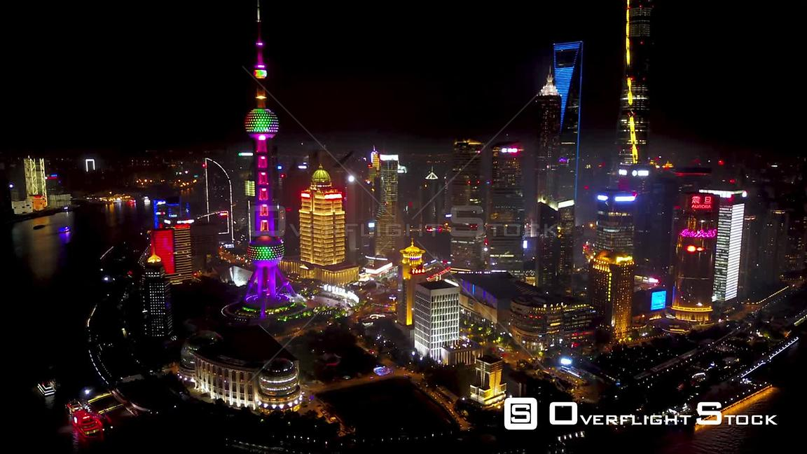 Shanghai  China Shanghai China Aerial Time Lapse Night  Flying from high to low into busy financial district.