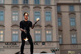 A performance artist plays with fire at Old Town Square in Prague, Czech Republic