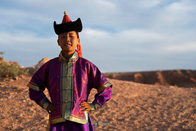 Portrait of a young kid at the Flaming Cliffs, Bayanzag, in the south Gobi desert, Mongolia.