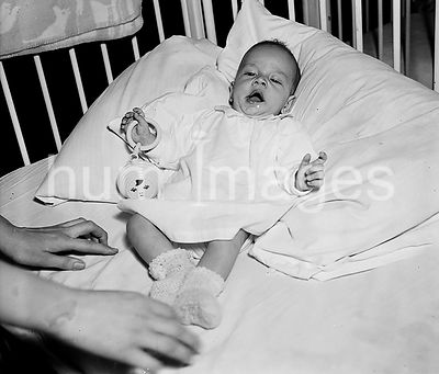 Toddler in a crib ca. 1935