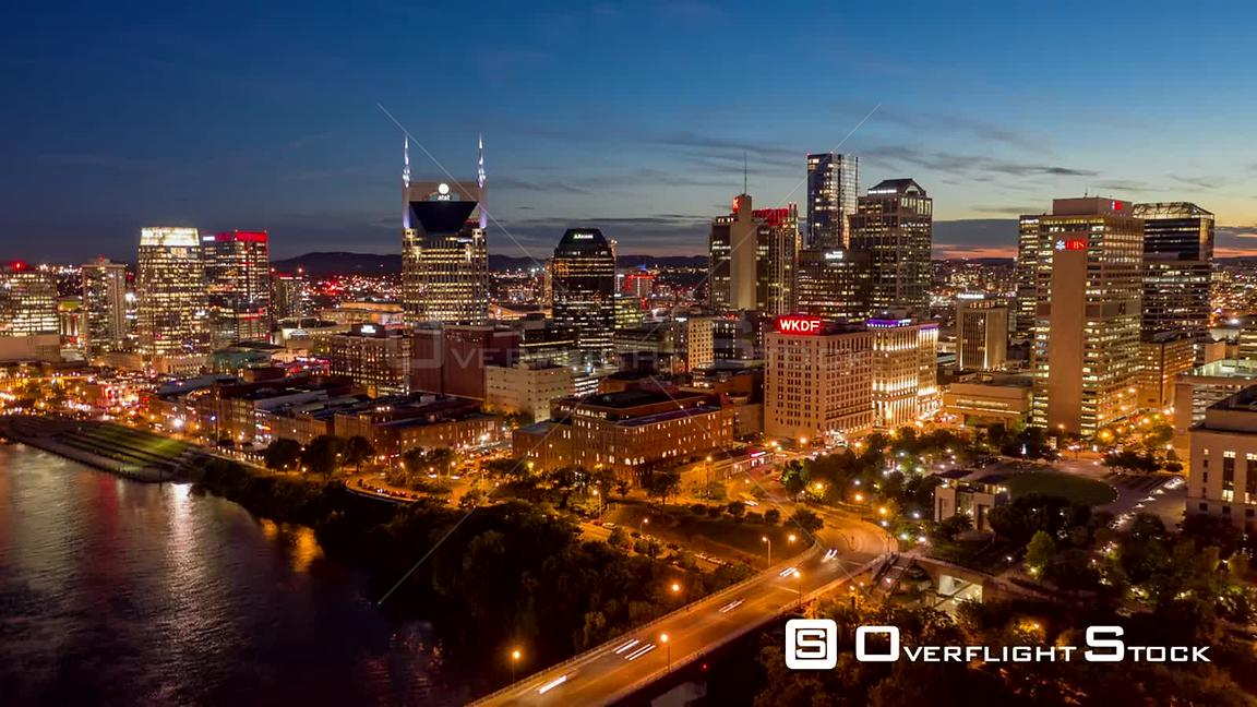 Tennessee Nashville Aerial Cityscape hyperlapse flying low over East Bank industrial near riverfront to Arts District