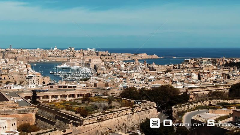 Aerial dolly view of the towns of Vittoriosa and Valletta and the entrance of the Grand Harbour in Malta