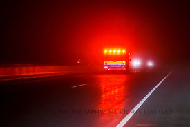 Ambulance Driving I-90 on a Rainy Night in Minnesota