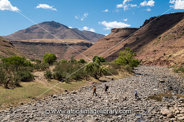 Tourists crossing the Tsatsane River near the Tsatsane bushman paintings, Lesotho