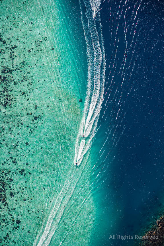 Trail of Jet Boats in Turquoise Waters off Moorea Island French Polynesia