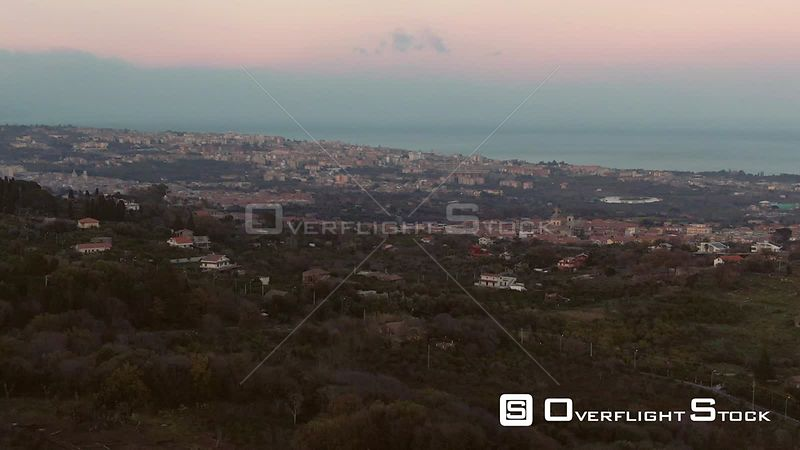 The Town of Acireale With the East Coast of Sicily in the Background at Sunset