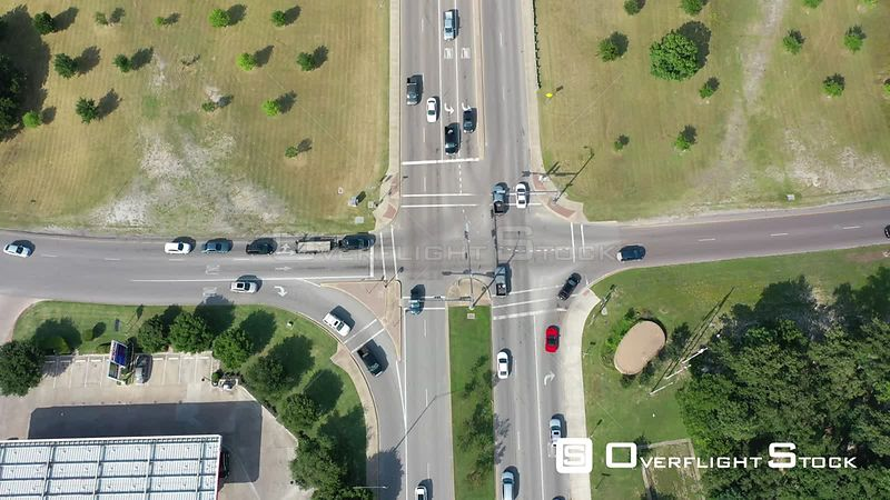 Descending flight over traffic at rush hour over intersection of Hwy 6 and University Blvd, College Station, Texas, USA